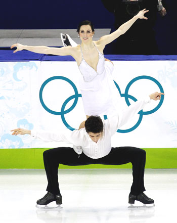 Canada's Tessa Virtue (top) and Scott Moir perform in the ice dance free dance figure skating event