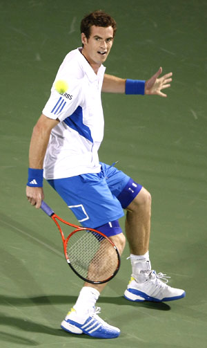 Andy Murray returns during his match against Russia's Igor Kunitsyn