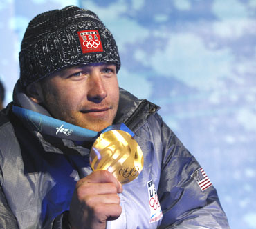 Alpine skiing gold medallist Bode Miller of the US poses with his medal during the medals ceremony