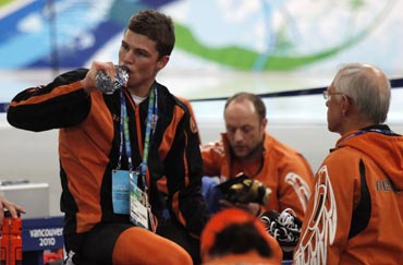Kramer of the Netherlands drinks from a bottle after the men's 10000 metres speed skating race