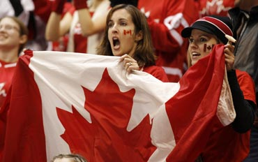 Canadian fans cheer for their team