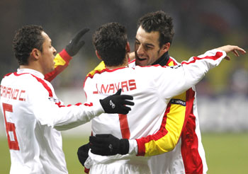 Sevilla's Adriano (left), Jesus Navas and Alvaro Negredo celebrate a goal during their Champions League soccer match against against CSKA Moscow