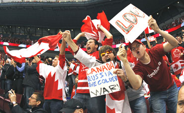 Canada hockey fans react in the stands during the ice hockey play-offs quarter-finals between Russia and Canada