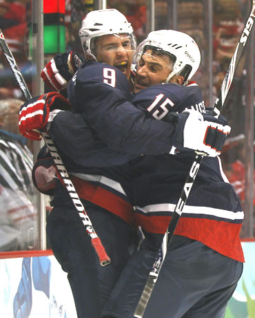 Zach Parise (left) of the US celebrates his goal with Jamie Langenbrunner during their ice-hockey quarter-finals against Switzerland