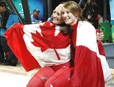 Canada's Kaillie Humphries (left) and Heather Moyse celebrate after winning gold in the women's bobsleigh event