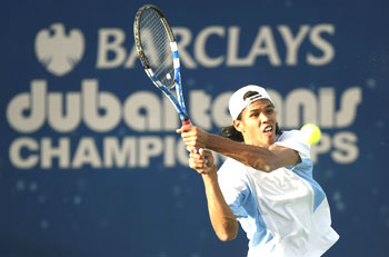 Somdev Devvarman returns a shot against Marcos Baghdatis during their second round tie at the Dubai C'ships