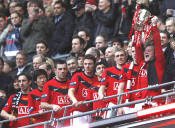 Manchester United player celebrate after winning Carlin Cup