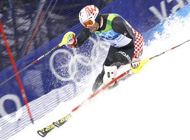Croatia's Ivica Kostelic clears a gate during the second run of the men's alpine skiing slalom event