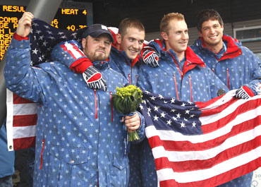American four-man bobsleigh team's Steven Holcomb, Justin Olsen, Steve Mesler and Curtis Tomasevicz celebrate after winning the gold