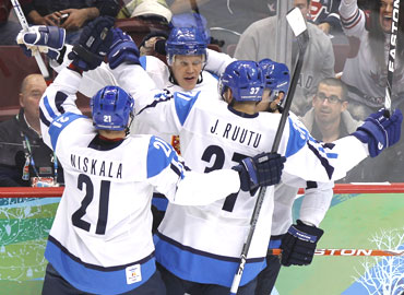 Finland's Olli Jokinen (centre) celebrates with his team-mates after scoring against Slovakia