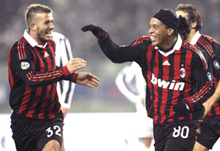 AC Milan's Ronaldinho (right) celebrates with team-mate David Beckham after scoring against Juventus on Sunday