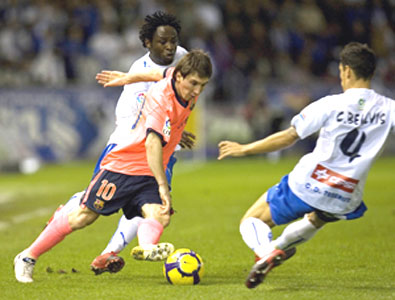 Barcelona's Lionel Messi (centre) is challenged by Tenerife's Carlos Bellvis (right) and Kome during their La Liga tie on Sunday