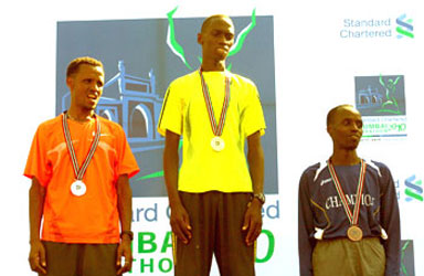 Denis Ndiso is flanked by 1st runners up Siraj Gena (left) and third place holder Samson Limareng