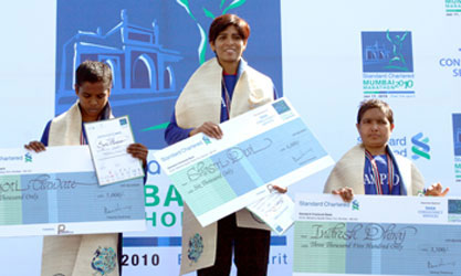 Winner Shastri Devi is flanked by Jyoti Gawate and Indresh Dhiraj