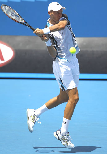 Russia's Nikolay Davydenko returns a shot against Ukraine's Illya Marchenko