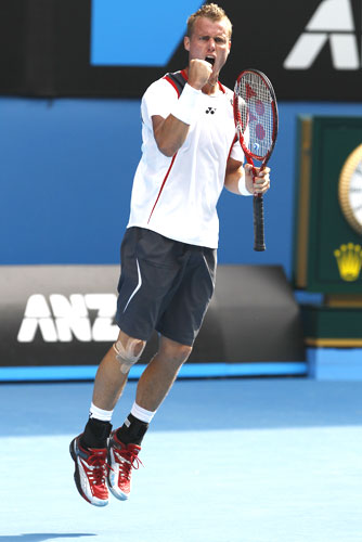 Lleyton Hewitt exults after defeating Donald Young of the US