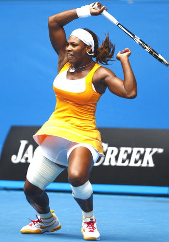 Serena Williams of the US returns a shot against Czech Republic's Petra Kvitova