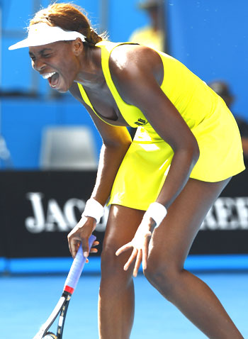 Venus Williams reacts during her match against Austria's Sybille Bammer