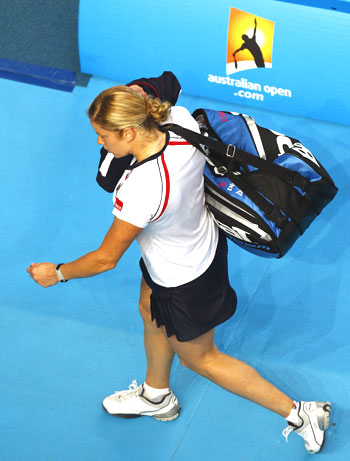 Kim Clijsters leaves the court after losing to Russia's Nadia Petrova