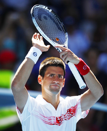 Novak Djokovic of Serbia waves after defeating Uzbekistan's Denis Istomin.