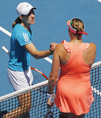 Justine Henin shakes hands with Nadia Petrova after winning their quarter-final