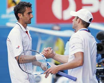 Marin Cilic and Andy Roddick shake hands at the conclusion of their quarter-final