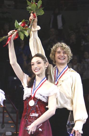 Meryl Davis (left) and Charlie White pose with their medals after winning the championship dance competition at the US Figure Skating Championships in Spokane, Washington, on Saturday