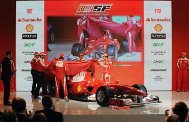 Fernando Alonso and Felipe Massa whip off the covers to reveal the new car