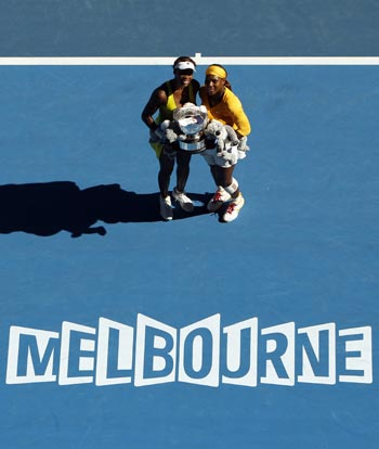 Venus (left) and Serena Williams with the Australian Open women's doubles title