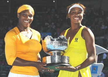 Serena and Venus Williams with the women's doubles trophy