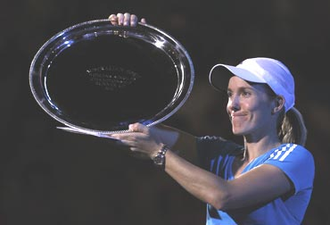 Justine Henin with the runners up trophy