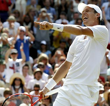 Tomas Berdych celebrates after beating Roger Federer