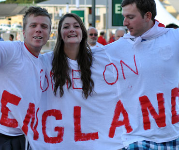 This English fan doesn't mind sharing her space or shirt with the guys