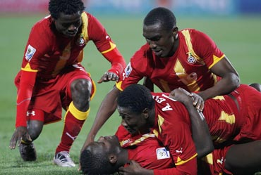 Ghana players celebrate after a goal