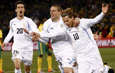 Diego Forlan (right) celebrates with team-maters