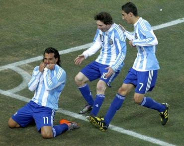 Carlos Tevez celebrates a goal