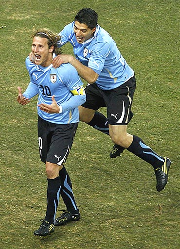 Uruguay's Diego Forlan (left) celebrates his goal with teammate Luis Suarez