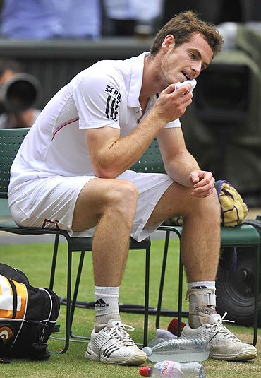 Britain's Andy Murray reacts after losing the match