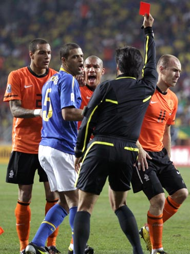 Referee Yuichi Nishimura flashes the red card to Brazil's Felipe Melo for his foul on Arjen Robben