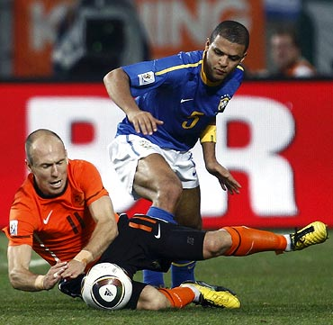 Felipe Melo (right) fouls Arjen Robben to receive a red card