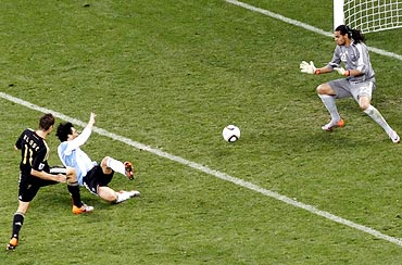 Miroslav Klose (left) scores the second goal for Germany