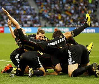 German team celebrates after winning their match
