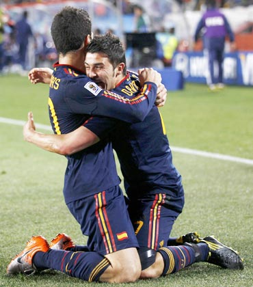 David Villa celebrates after scoring against Paraguay