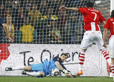 Iker Casillas saves a penalty by Paraguay's Cardozo