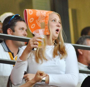 A Netherlands fan reach during a match