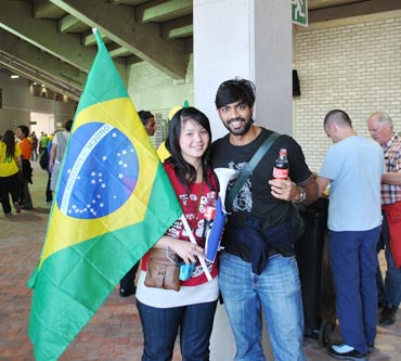 People from different nationalities support Brazil