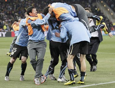 Uruguay team celebrate after making it to the semi-finals
