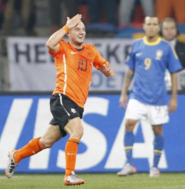 Wesley Sneijder celebrates after scoring the winner against Brazil