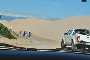 The sand dunes along the coast of Nelson Mandela Bay...on a day like this, they blow across the road, rendering it unusable