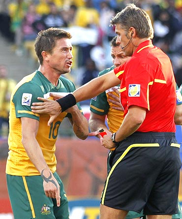 Australia's Harry Kewell (centre) reacts to being shown the red card by referee Roberto Rosetti during a match against Ghana
